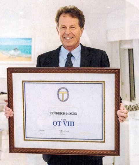 Scientology uber-lawyer Kendrick Moxon proudly displays his OT 8 certificate. The highest level of his religion, it takes 8 years or more of study to achieve.