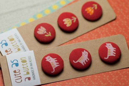Red screenprinted fabric buttons, by ana aceves