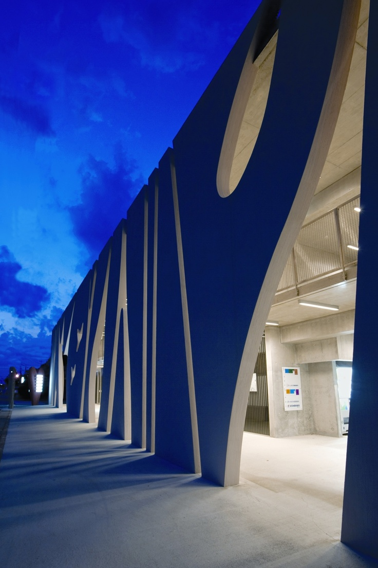 Night view of Medical Centre Stripes in Japan by Eastern Design Office
