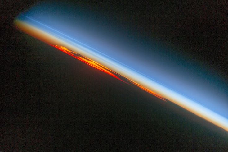 Fiery South Atlantic Sunset: An astronaut aboard the International Space Station photographed a sunset that looks like a vast sheet of flame. With Earths surface already in darkness the setting sun the cloud masses and the sideways viewing angle make a powerful image of the kind that astronauts use to commemorate their flights.