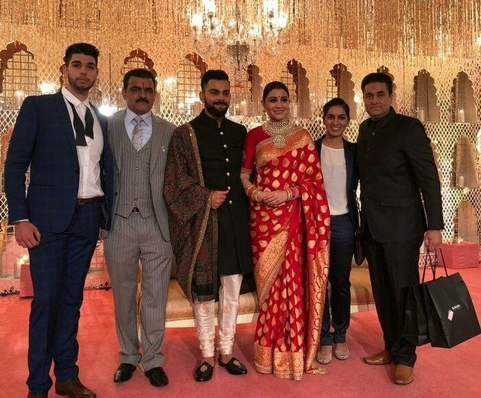 anushka Sharma and Viratkohali at receiption with family members