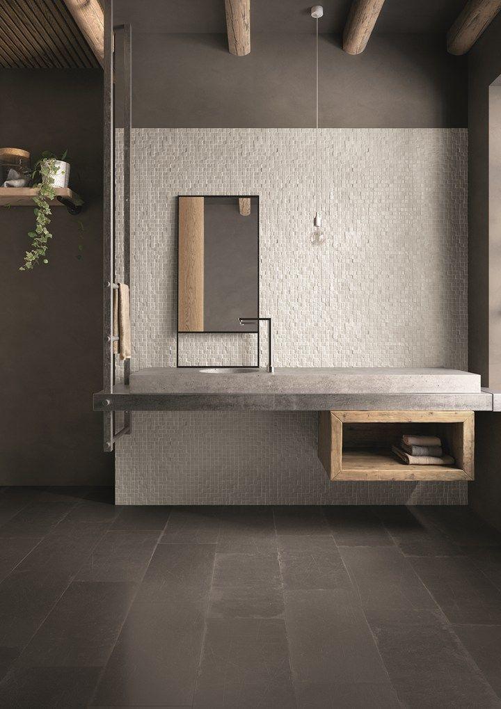 Madeira e concreto se deram super bem neste banheiro minimalista, concorda? O resultado foi um ambiente rústico sem perder o ar moderno!