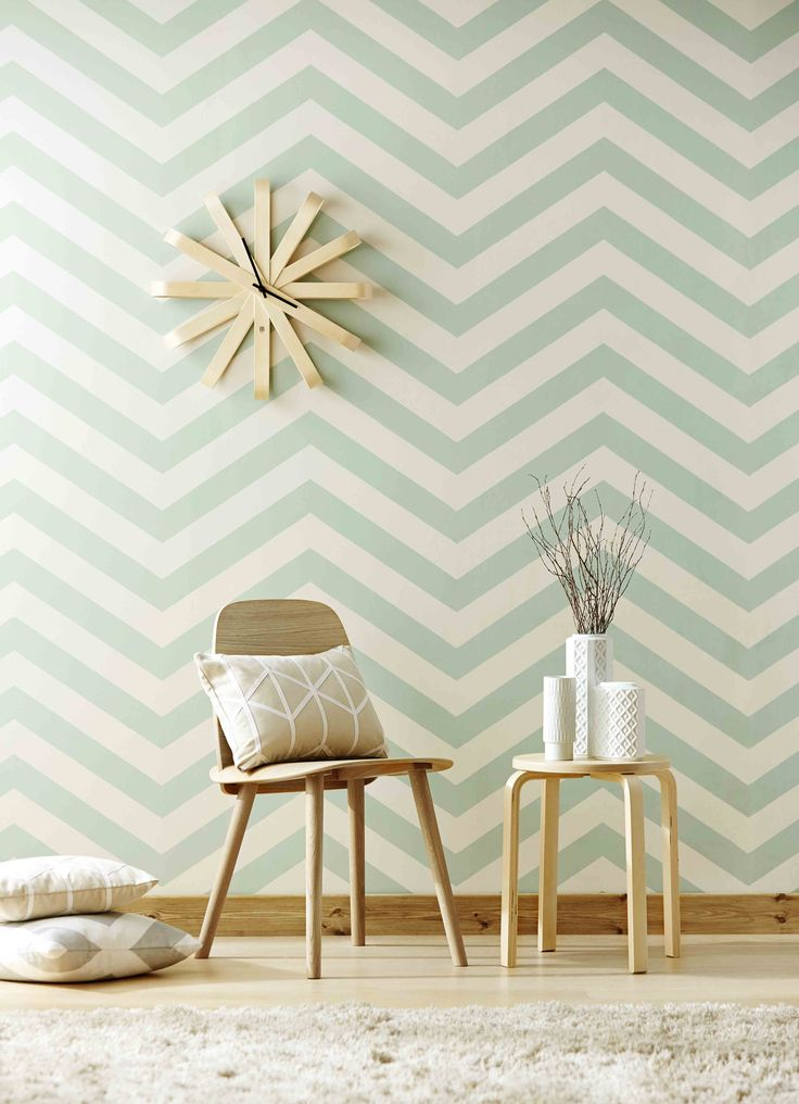 Vector, our trend-led chevron wallpaper, is ideal for a modern living room full of mid-century charm.