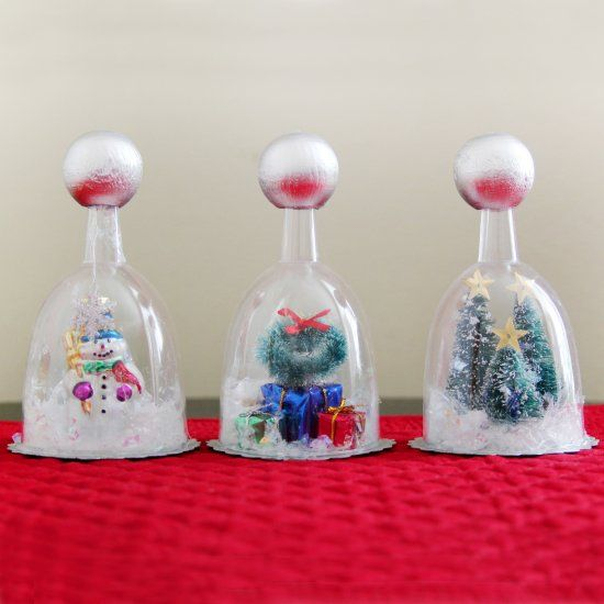 Create one of a kind snow globes using inexpensive plastic wine glasses and your choice of miniature holiday items. Full photo tutorial.