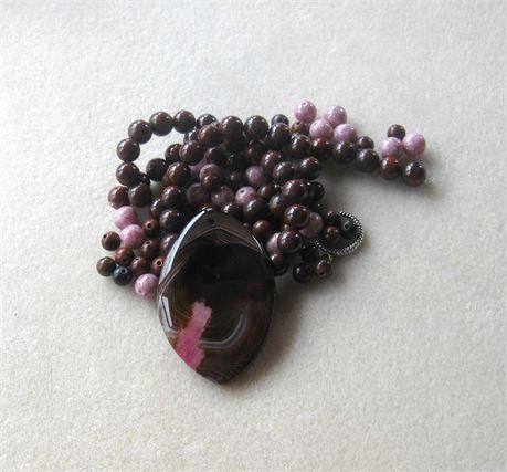 These DIY jewelry kits contain a pendant with coordinating beads and findings so you can easily make a necklace with one stop shopping!    *  brown pink agate marquis pendant, top drilled front to back, 33 x 51 x 6mm (dyed)   *  poppy jasper round beads, 15 strand, 8mm   *  mahogany obsidian round beads, 6mm   *  pink glass round beads, 6mm   *  antiqued silver spacers, 6mm   *  antiqued silver designer toggle clasp, 16mm   Each kit comes with 4 crimp beads and 20 inches of beadalon…