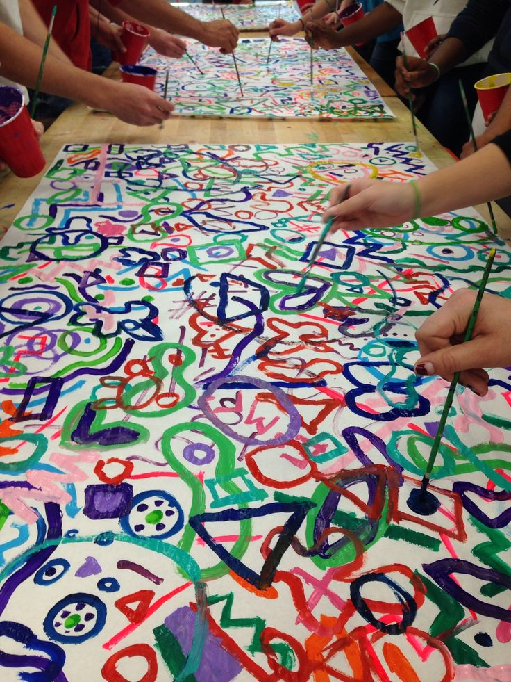 This collaborative painting was done by a high school class of male and female students between 9th and 12th grade. Students were inspired by Kandinsky to create a movement of overlapping shapes, colors and lines to the rhythm of different types of music. Every minute for 30 minutes, students rotated around the painting to spread their personal touches throughout.