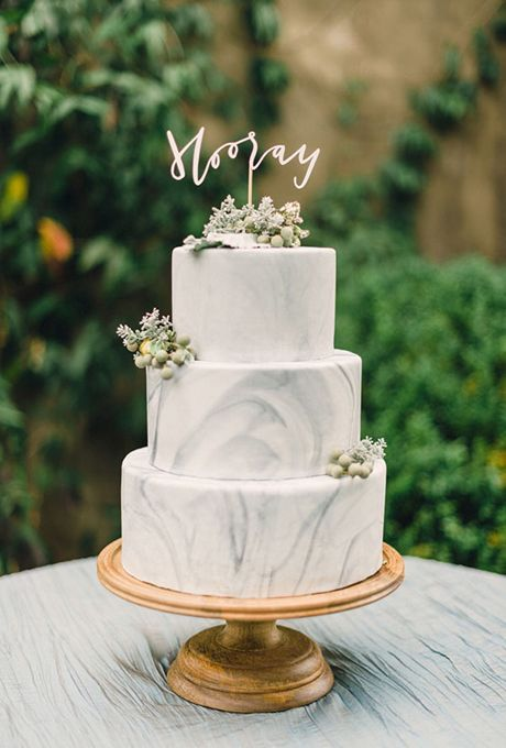 White and Gray Marble Wedding Cake. Marble-frosted wedding cakes always make us say 'Hooray!'