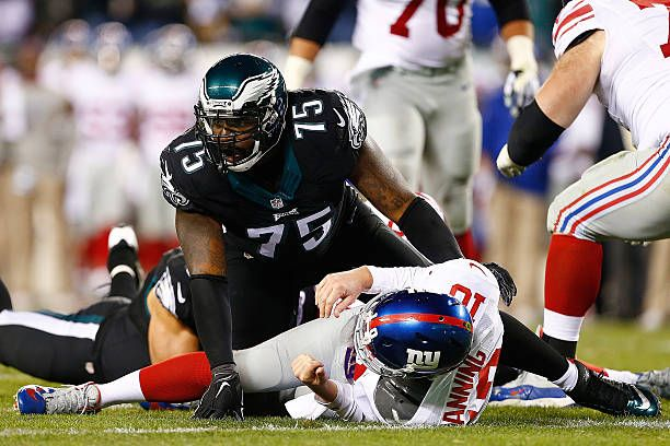 Eli Manning #10 of the New York Giants is taken down by Vinny Curry #75 of the Philadelphia Eagles during the third quarter at Lincoln Financial Field on October 19, 2015 in Philadelphia, Pennsylvania. The Philadelphia Eagles defeated the New York Giants 27-7.