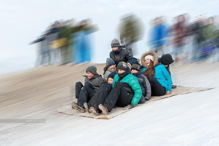 Linoleum slalom - Collective descent from the snow-covered hills on the magical linoleum. Temryuk, winter 2015. Krasnodar region, Russia.