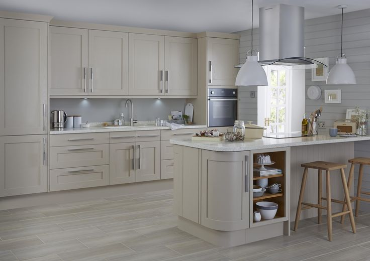 A warm, neutral colour palette can breathe new life into a design classic. This modern take on a Shaker style kitchen, complete with breakfast bar, invites you to pull up a stool and join the conversation.
