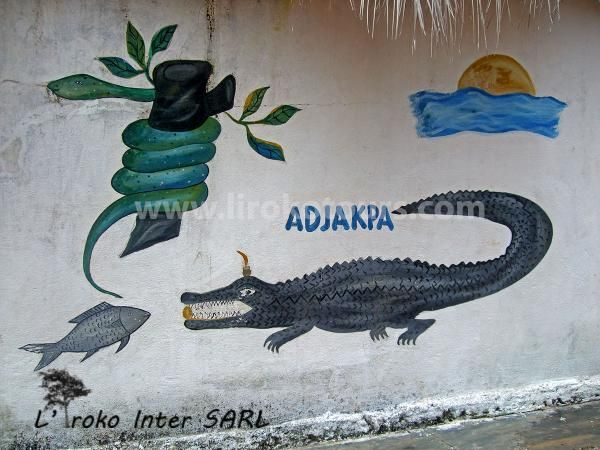 Voodoo paintings with crocodile and python a sacred animal in Africa