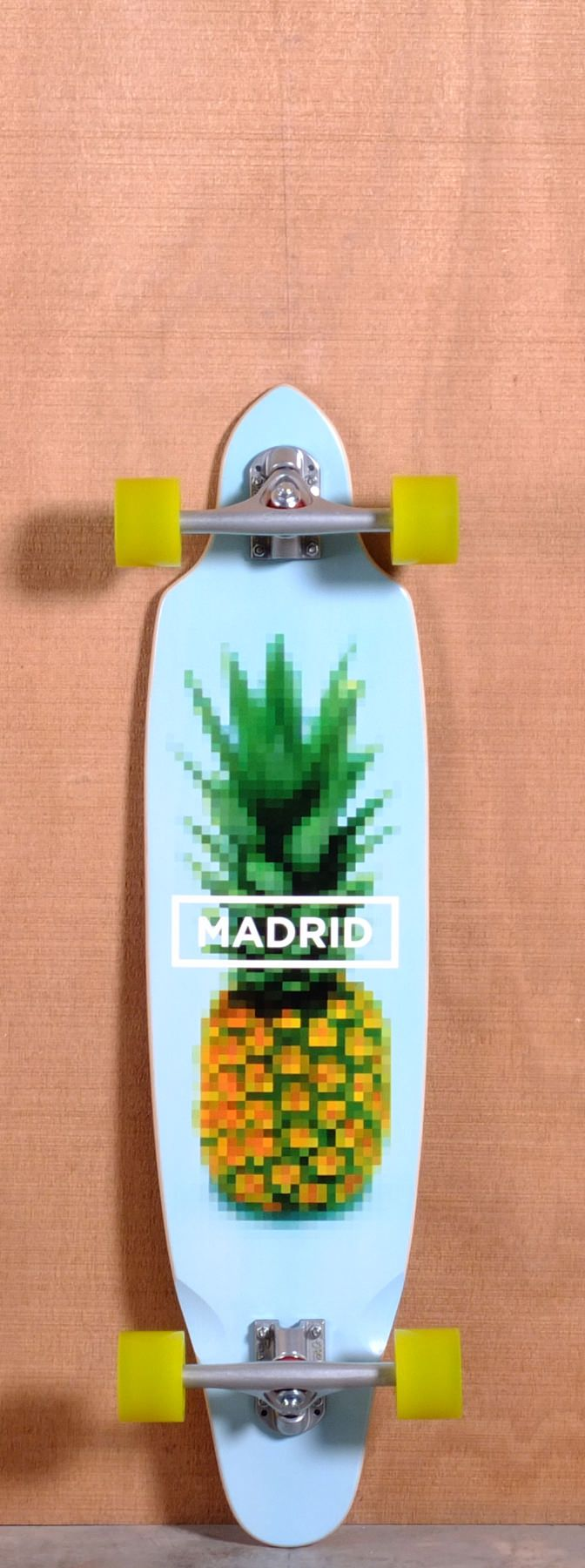 """The Madrid Pineapple Longboard Complete is designed for Cruising and Carving. Ships fully assembled and ready to skate! Function: Cruising, Carving Features: Camber, Concave, Kick Tail, Sanded Wheel Wells Material: 7 Ply Maple Length: 36"""" Width: 9"""" Wheelbase: 23.75"""" Thickness: 7/16"""" Hole Pattern: New School Grip: Black"""