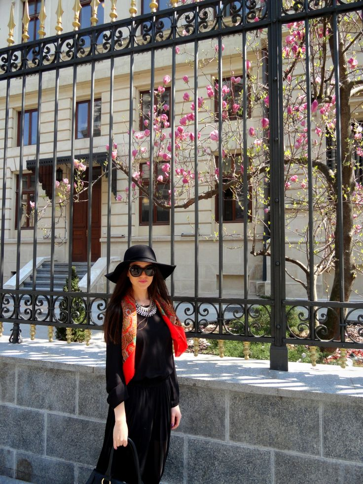 Bucharest . spring . sunny day . black hat . necklaces . sunglasses . red scarf . long skirt