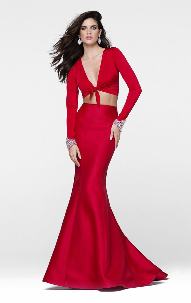 Look like a modern day roman goddess in this two piece set gown tarik ediz long sleeved with beaded cuffs and knotted bodice feature the crop top