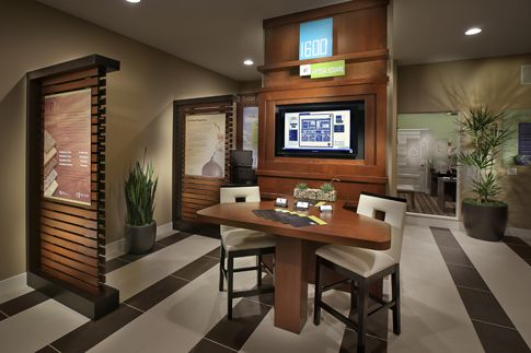 1600 at artesia square by mbk homes sales office interior for Sales office design ideas