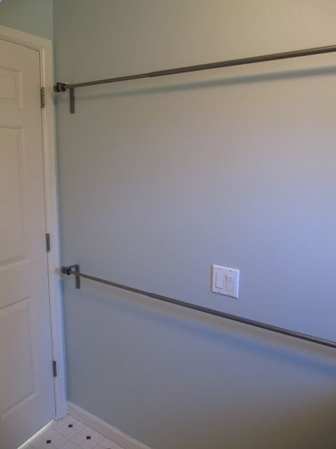 Use stacked curtain rods in laundry room to hang dry clothes or to air dry wet clothes... brilliant!