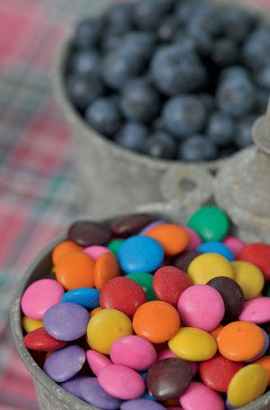 Fill tin buckets with colourful sweets and yummy berries for kids to enjoy and to create that rustic feeling.