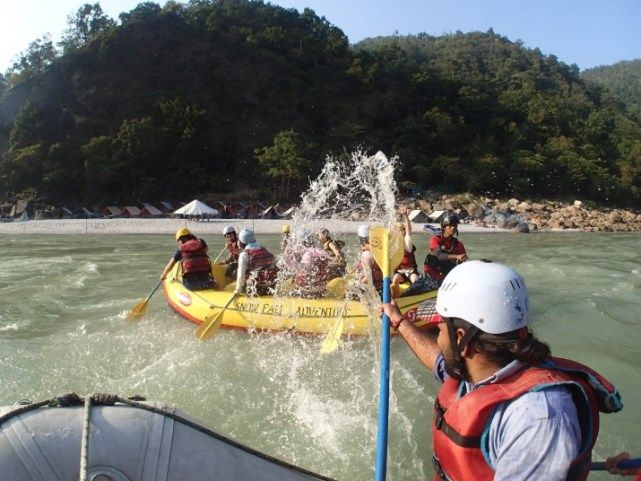 Having fun during the river rafting outing