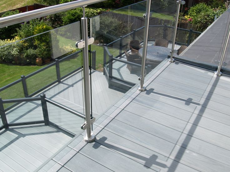 Fensys UPVC decking with matching balcony and glass panelling