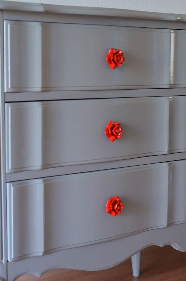French Dresser Makeover. Rosette drawer pulls (from Pier One Imports, painted red).