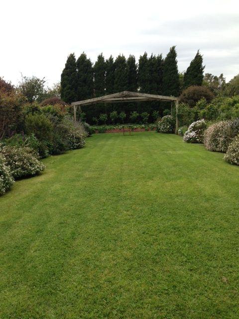 The Sunken Garden with wooden arbour Location: Morning Star Estate