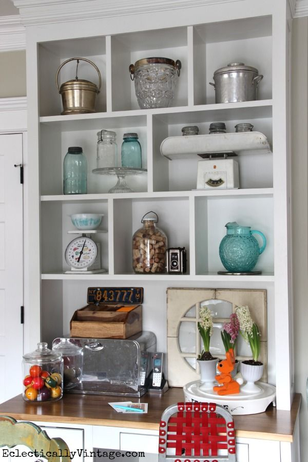 Styling open shelves - love these fun collections! eclecticallyvintage.com