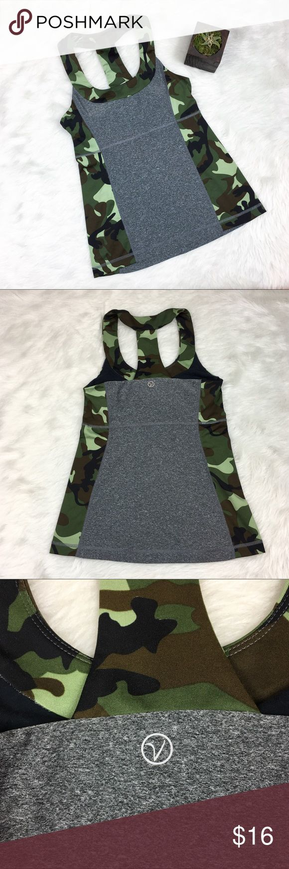 VOGO by Athletica Camo Workout Tank Top VOGO by Athletica camo, grey, & black workout tank top. Size extra small. Approximate measurements flat laid are 23' long & 13' bust. GUC with no major flaws and some basic wear. Has built in bra without pads. Does have a place to put pads. Back of built in bra is a mesh. Moisture wicking material. ❌No trades ❌ Modeling ❌No PayPal or off Posh transactions ❤️ I 💕Bundles ❤️Reasonable Offers PLEASE ❤️ VOGO Tops Tank Tops