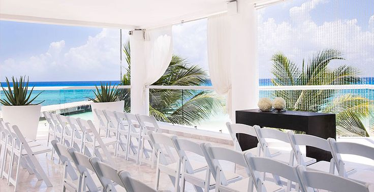 Striking view of the Caribbean from the waterfront chapel at Playacar Palace in Mexico | Palace Resorts Weddings ®