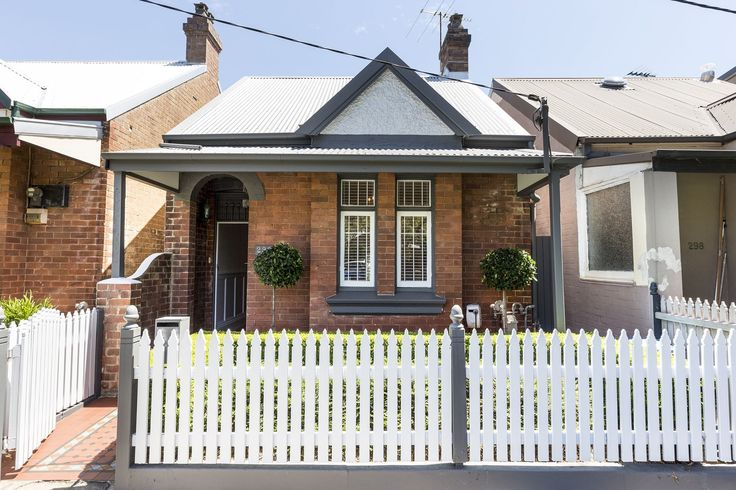 296 Trafalgar Street, Annandale NSW Front of house painting. White picket, dark grey paint.