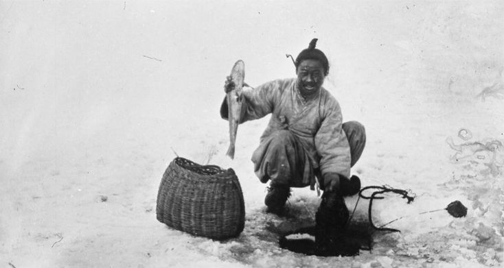 A man catches fish on a frozen river. Trout soup from the Taedong river is a typical Pyongyang dish, and ice fishing from frozen rivers during Korea's cold winter remains popular today. South Korea even holds an annual ice-fishing festival.