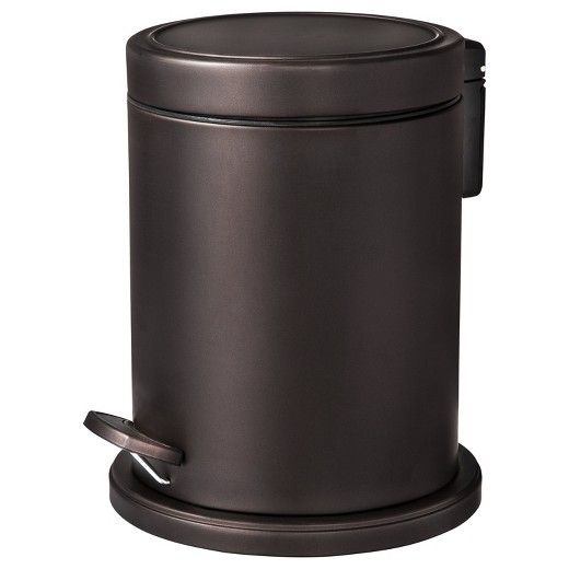 Who knew a garbage can could look so good? This Step Can from Threshold is beautifully finished with a bronze powder coat. At just under a foot high, this is the perfect small trash can for a bathroom. This step-on wastebasket allows for hands-free opening closing, for clean and easy trash disposal.