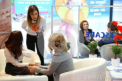 Female customer at tourism fair - stands at tourism fair in Bucharest, Romania.