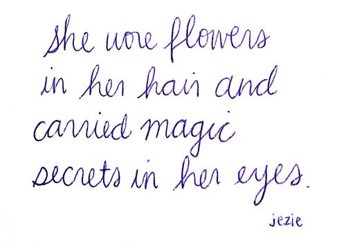 she wore flowers in her hair and carried magic secrets in her eyes
