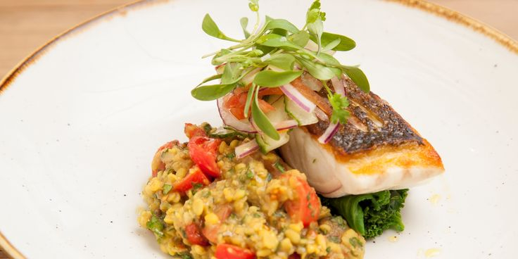 Dominic Chapman pairs the delicate flavour of sea bass with the punch of Indian spices with his tarka dhal recipe. An aromatic mixture of soft yellow lentils cooked slowly with toasted spices including cumin, coriander and ginger, the dhal is finished with fresh cherry tomatoes and coriander for balance.