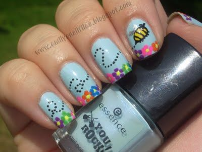 Whimsical manicure with little bee