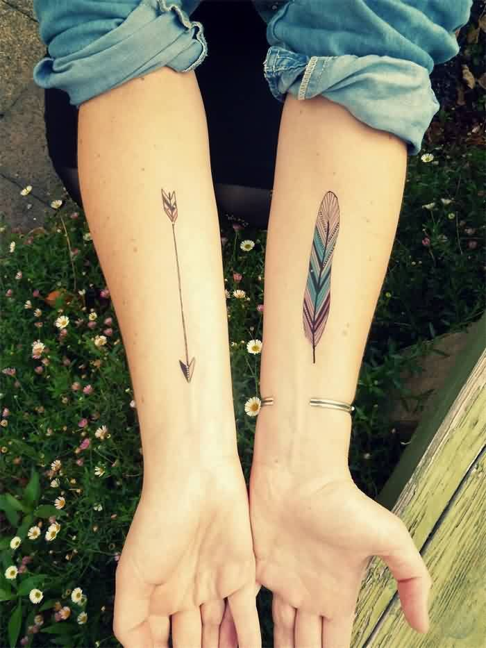 Arrow And Colourful Feather Tattoo For Women's Arm - Tattooshunter.com                                                                                                                                                     More