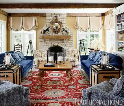 "I don't care for the fireplace or window treatment, but sure love the blue sofas, chairs and rug  The designer replaced heavy window treatments with custom shades in Pindler & Pindler fabric to lighten the space. Fireplace chairs are covered in ""Rajah"" by Cowtan & Tout."