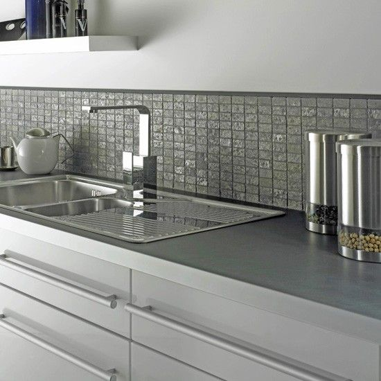 Looking for a simple and clean look? How about pairing grey mosaic tiles with white kitchen cabinets? Take a look at our complete collection of kitchen tiles at http://www.glasstilestore.com/