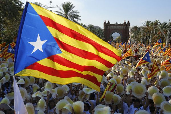 People wave 'Estaladas' (pro-independence Catalan flags) as they gather during a pro-independence demonstration, on September 11, 2016, in Barcelona during the National Day of Catalonia 'Diada'..The 'Diada' marks the date (September 11, 1714) when Barcelona fell to Spanish and French forces in the War of Succession, that redrew the map of Spain. Tens of thousands of Catalans gathered in Barcelona and four other cities today for mass rallies to demand their region break away from Spain, as…