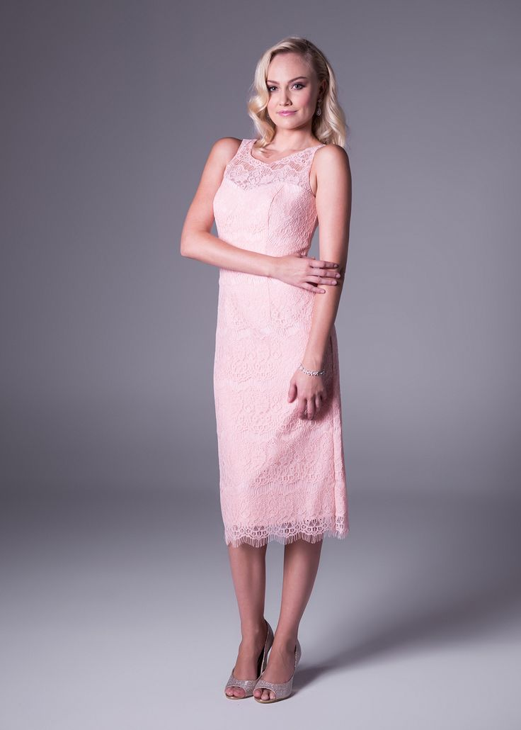You had us at hello! Ultra feminine, this short soft pink #lace #dress from Bride&co with a high neckline will remain a winner in your closet for every elegant function you attend (style VC2820). Click to View More or Book a Fitting.