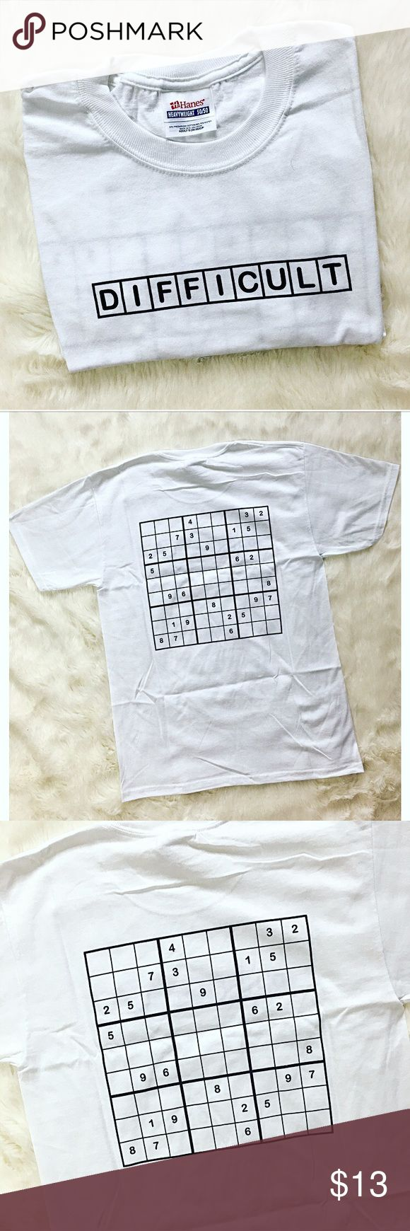 🆕 Sudoku Puzzle T-Shirt Unisex fit.  Perfect for the puzzle lovers!  A t-shirt with a difficult sudoku puzzle to fill in on the back.  Use washable marker to do it again and again!  Puzzle in photo is just an example, actual puzzle may vary in specificity but not level of difficulty. Shirts Tees - Short Sleeve