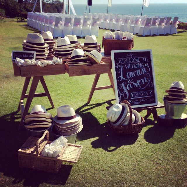 Display for hats & fans for an outdoor wedding