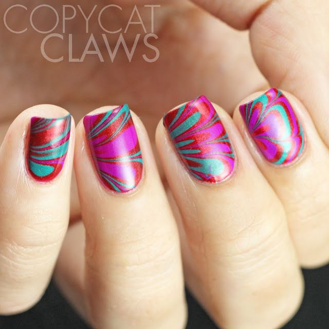 Red, purple and aqua water marble