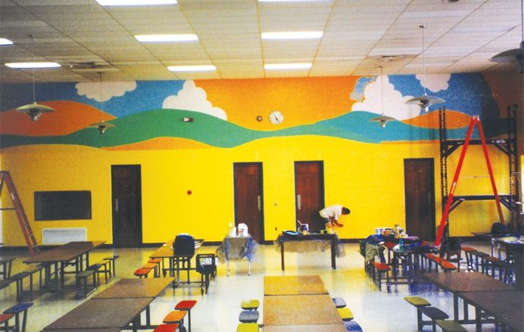 Bright, cheerful colors and a mural that conjures up a perfect day in the country greet the students at Hajjar Elementary School as they enter the cafeteria for breakfast or lunch. You can almost hear the birds chirping and the rooster crowing with scenes straight out of Old MacDonald's farm. Students enjoy their nutritious meals surrounded by blue skies, billowing clouds and a bright, yellow sun. Start your day with sunshine!