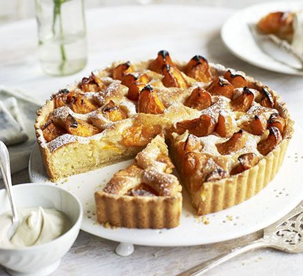 A showstopping fruit tart with homemade shortcrust pastry and squidgy almond filling - serve with crème fraîche