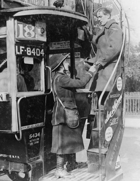 Number 18, Willesden route, conductress selling a ticket to an RFC serviceman c 1916