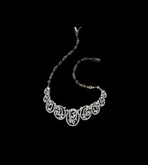 Tanishq : necklace from Tanishq's new Inara collection of wedding jewellery showcases brilliant diamonds set in yellow and white gold.