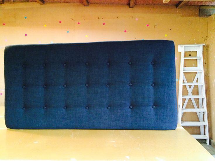 Black shallow buttoned beauty! This headboard is simple but makes a big statement.