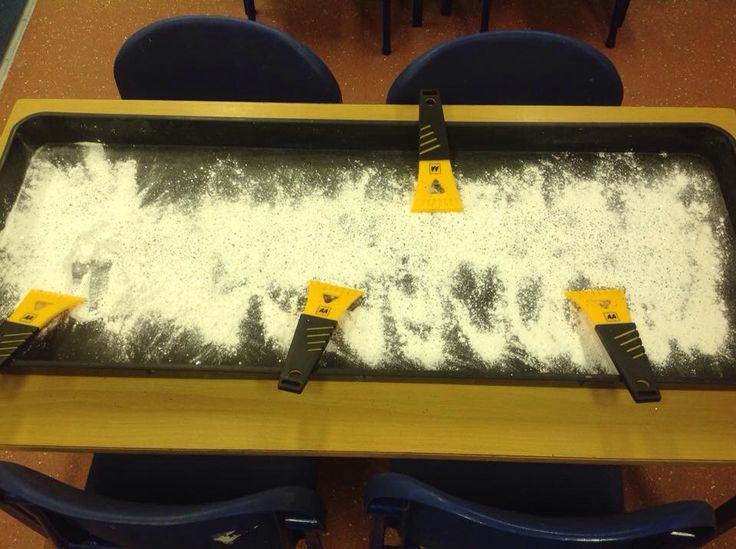 Mark making with ice scrapers in glittery icing sugar. Great Early Years activity!