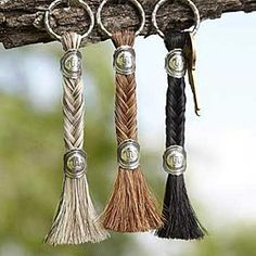 "HORSE HAIR KEYCHAIN Each authentic horse hair keychain is approximately 5"" long and features a split ring at one end and a horse hair tassel. The tassel is finished off with a distinctive sterling silver concho that features the Running W® Brand. Available in Grey, Black, or Brown krsaddleshop.com"